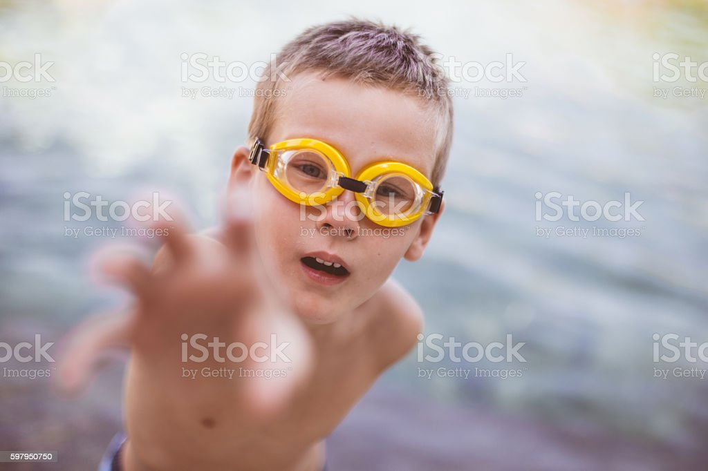 Boy in goggles reaches for fun stock photo