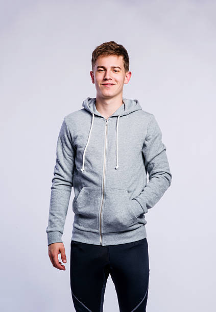 boy in gray sweatshirt, young man, studio shot - sweatshirt stock photos and pictures