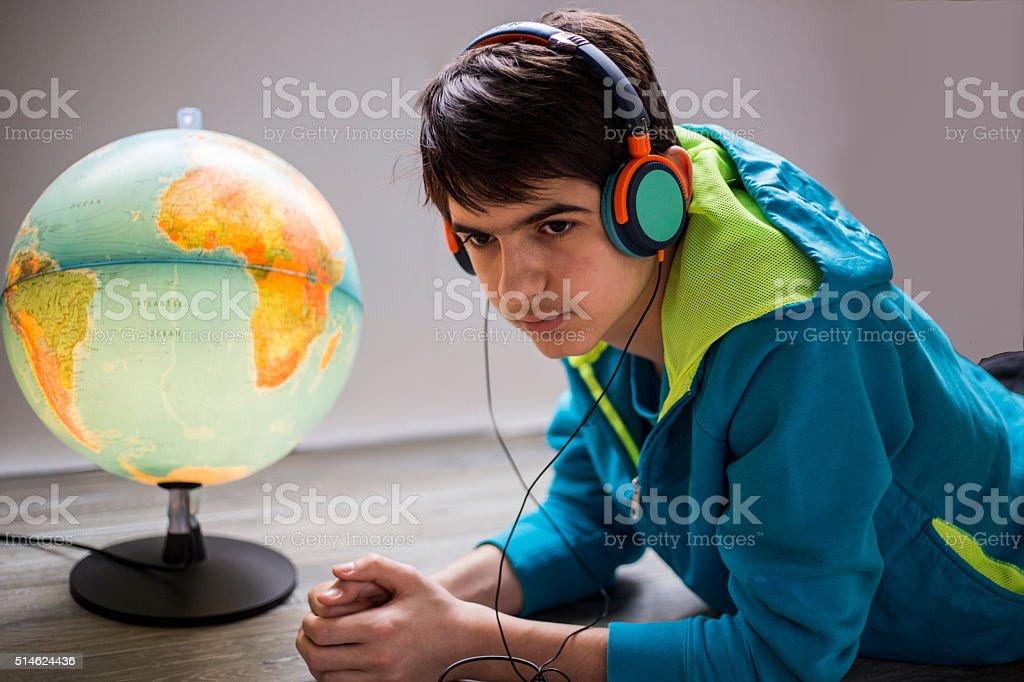 boy in headphones listening to music stock photo