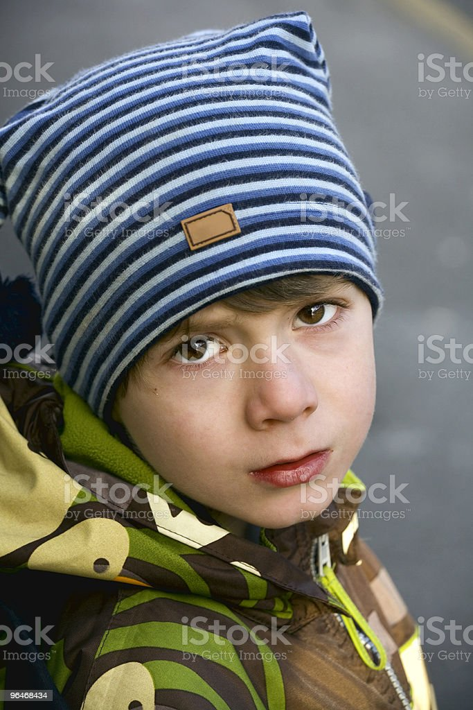 Boy in jackets and cap royalty-free stock photo