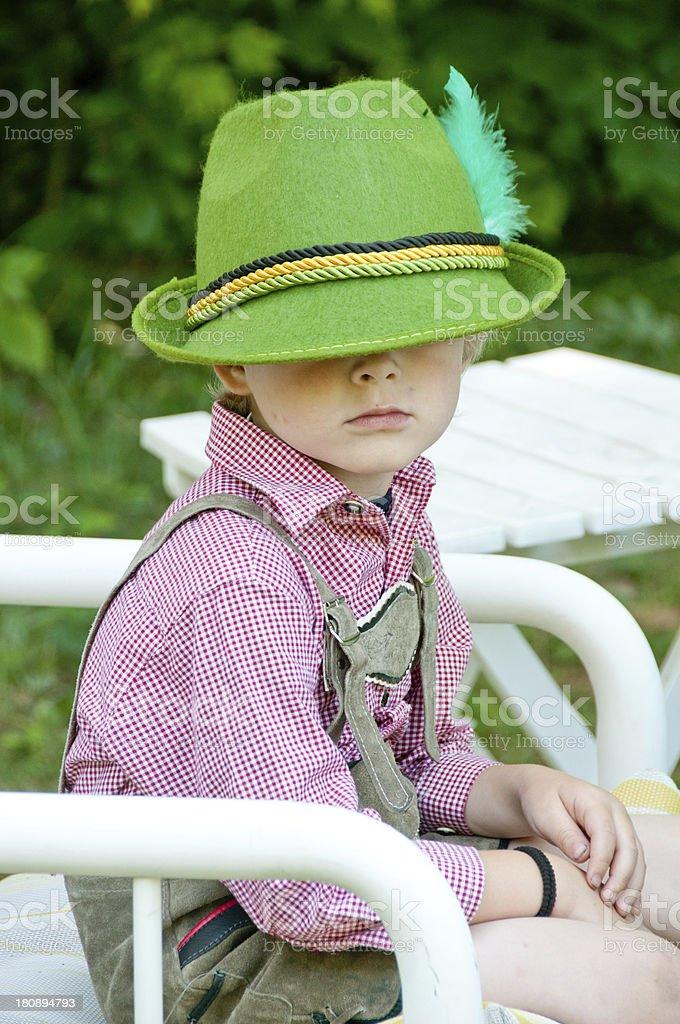 Boy in lederhousen and hat royalty-free stock photo