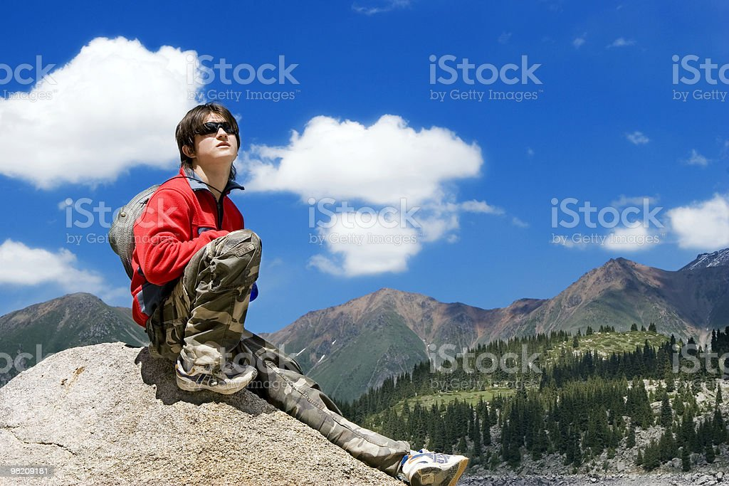 Boy in mountains hike at summer vocations, Tien Shan royalty-free stock photo