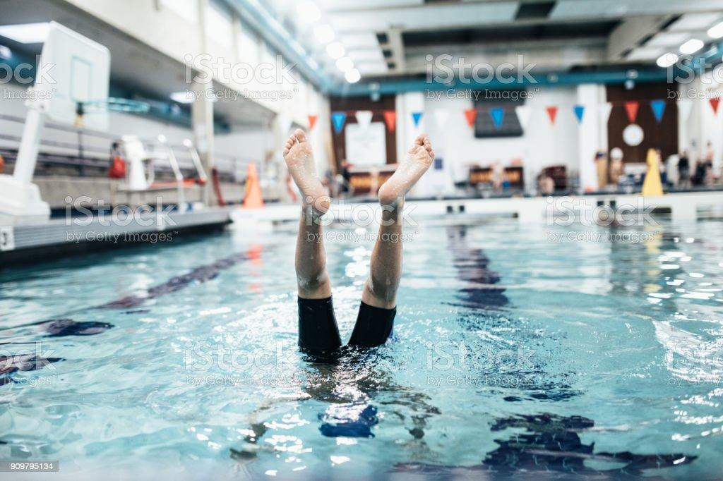 Boy In Pool for Swim Practice stock photo