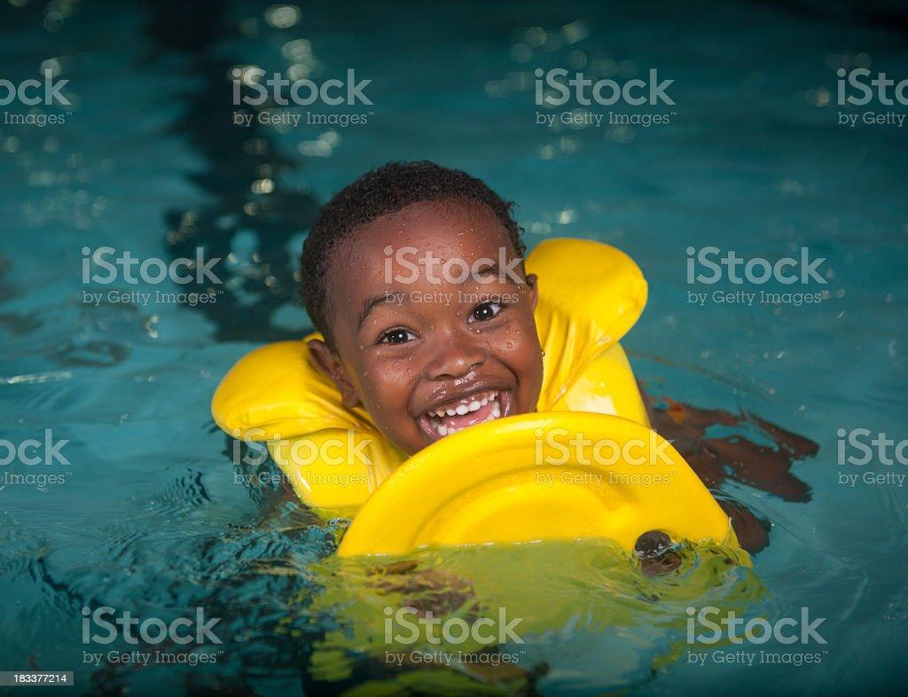Boy in pool stock photo