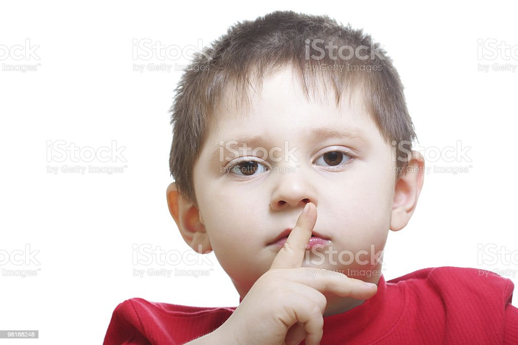Boy in red showing hush gesture royalty-free stock photo