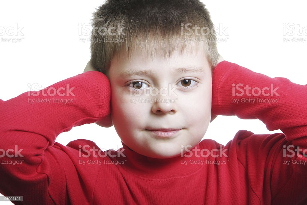 Boy in red shutting ears royalty-free stock photo