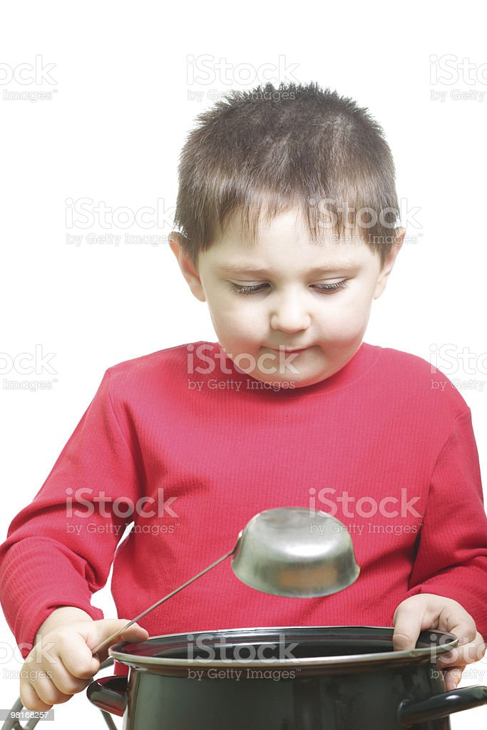 Boy in red with saucepan royalty-free stock photo