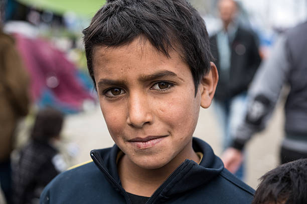 Boy in refugees camp in Greece stock photo