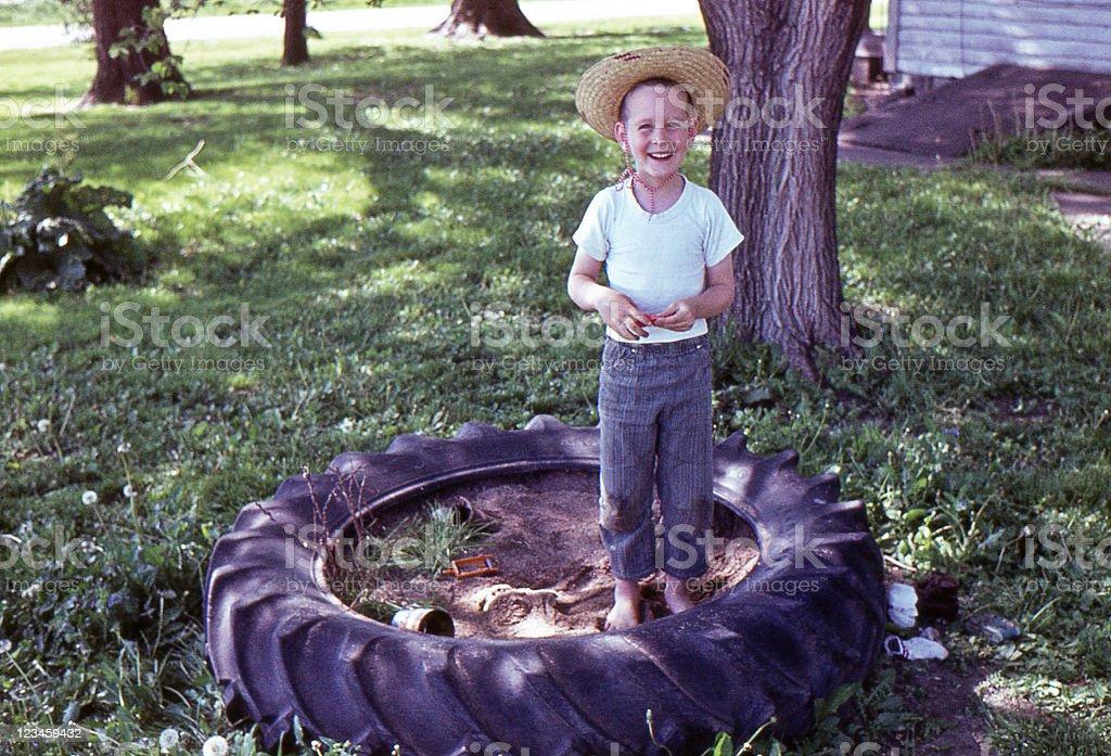 boy in sandbox 1964, retro royalty-free stock photo
