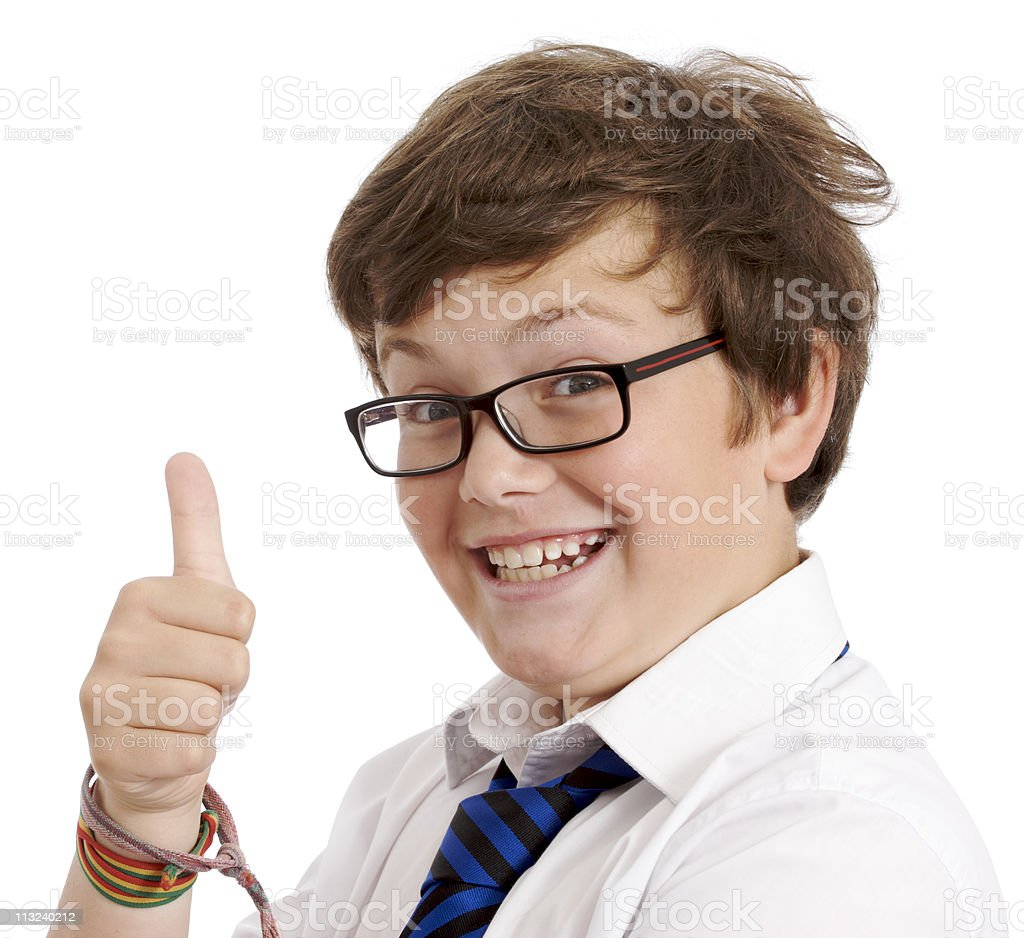 Boy in school uniform giving with thumbs up royalty-free stock photo