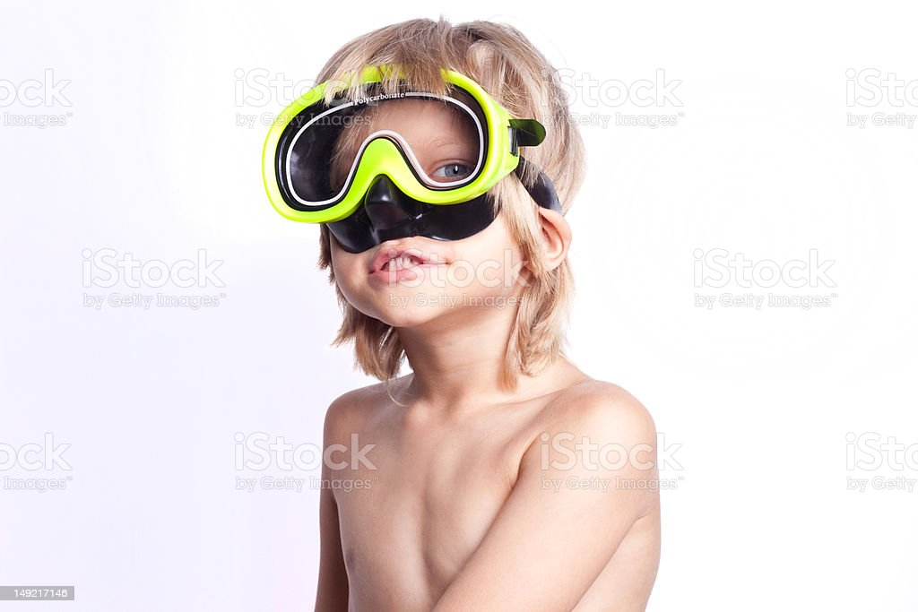 Boy in snorkel mask stock photo