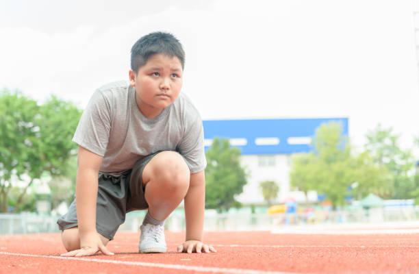 boy in starting position ready for running. stock photo