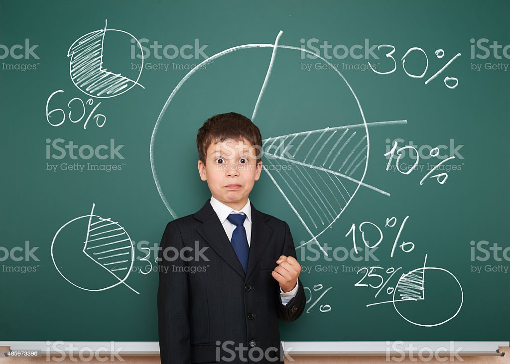 boy in suit show graphs on school board stock photo