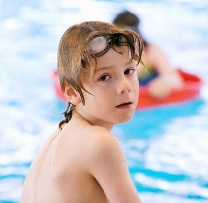 Boy In Swimming Pool Stock Photo & More Pictures of Blue