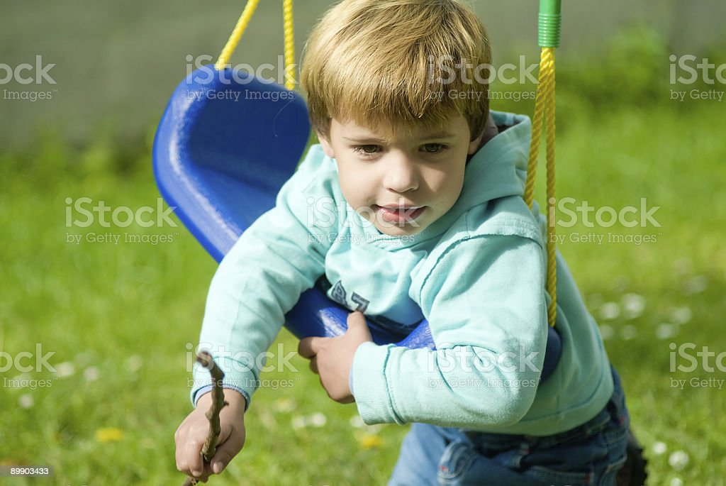 boy in swing royalty-free stock photo