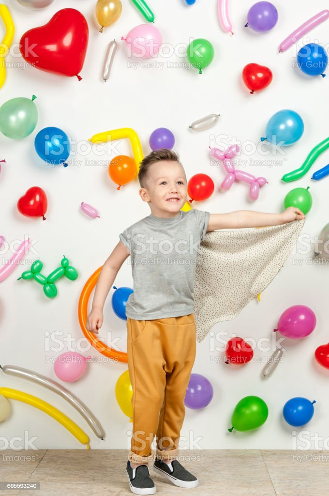 boy in the background of balls stock photo