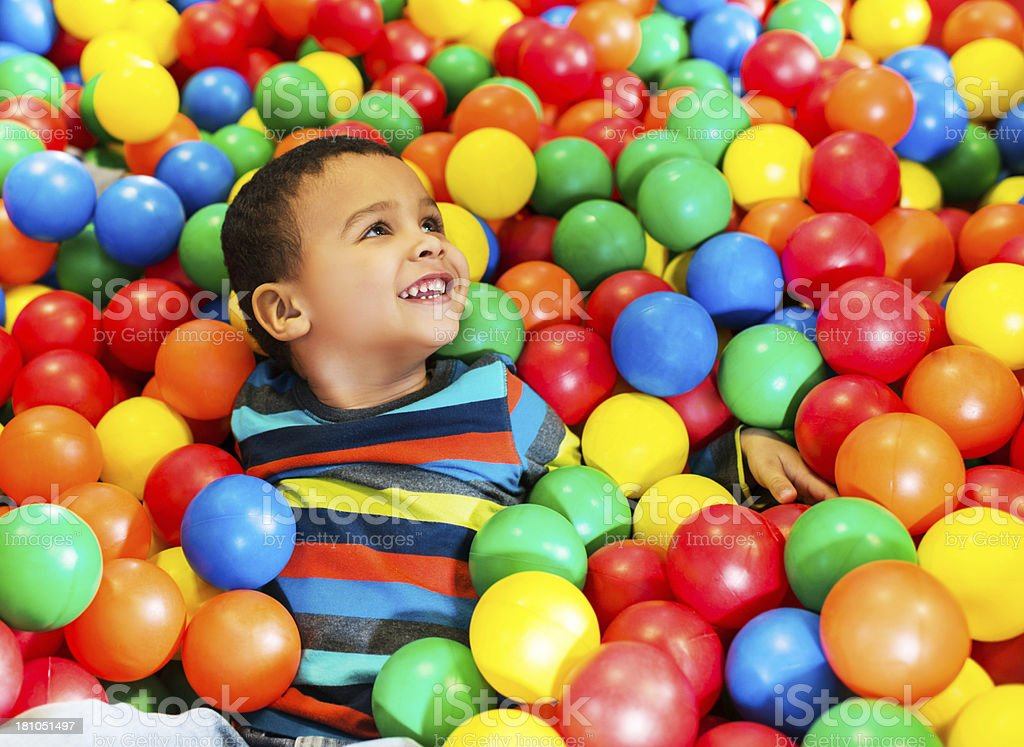 Boy in the balls. stock photo