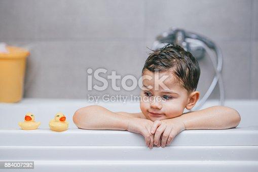 Cute little boy taking a bath