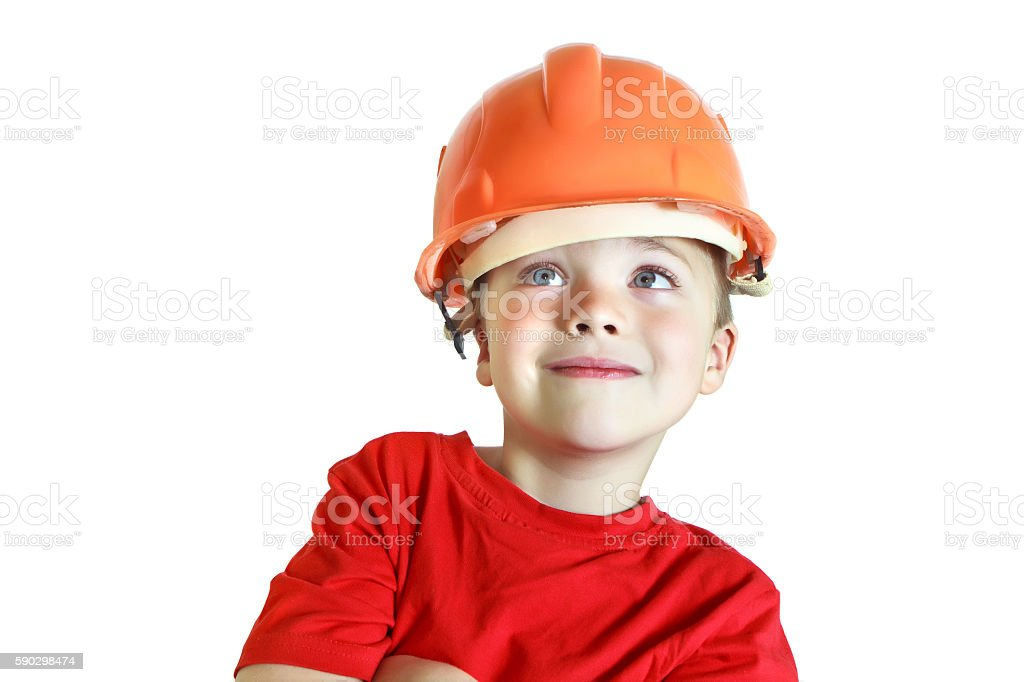 Boy in the construction helmet smiling royaltyfri bildbanksbilder