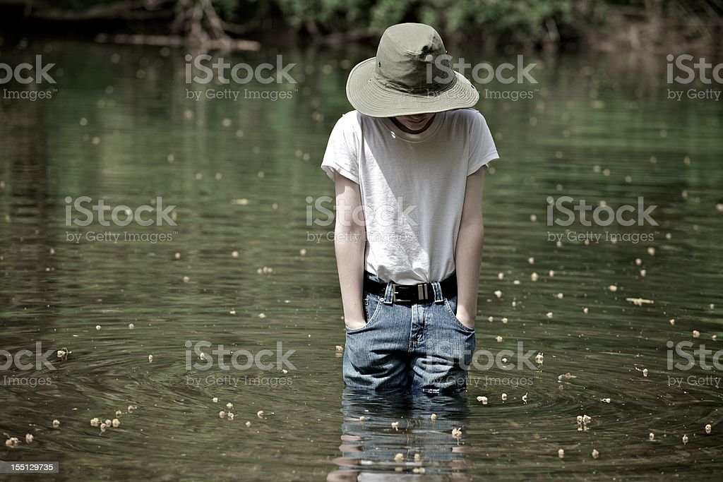 Boy in the creek stock photo
