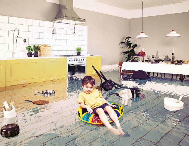 boy in the flooded room - flooded room stock photos and pictures