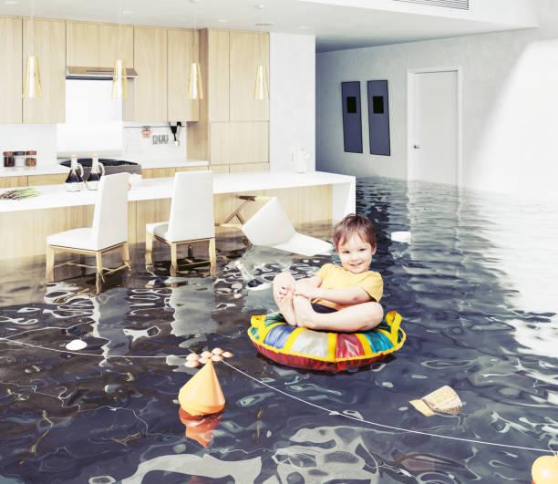 muchacho en la sala inundada - basement fotografías e imágenes de stock