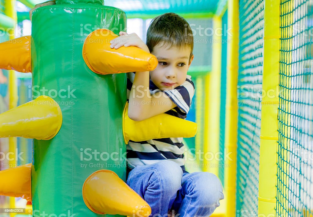 boy in the game maze stock photo