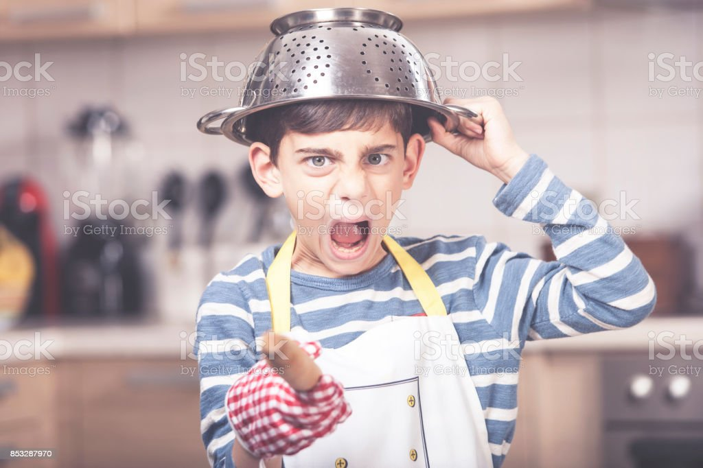 Boy in the kitchen stock photo