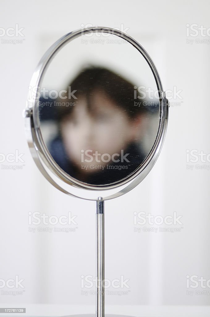 Boy in the mirror (defocussed for anonymity) royalty-free stock photo