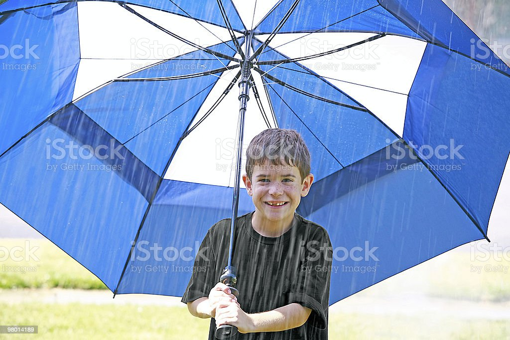 Boy in the Rain royalty-free stock photo