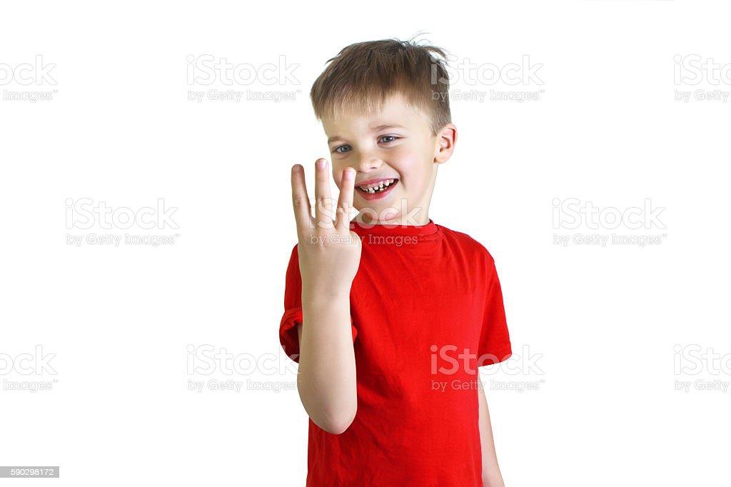 Boy in the red shirt showing three fingers royaltyfri bildbanksbilder