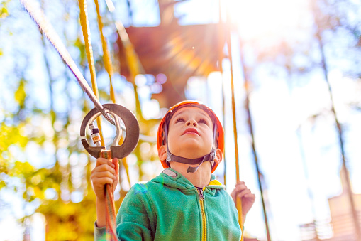 istock boy in the rope park looking up 508941620