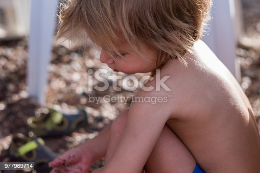 boy is playing in sand