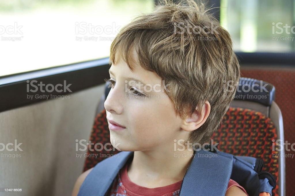 Boy in the school bus stock photo
