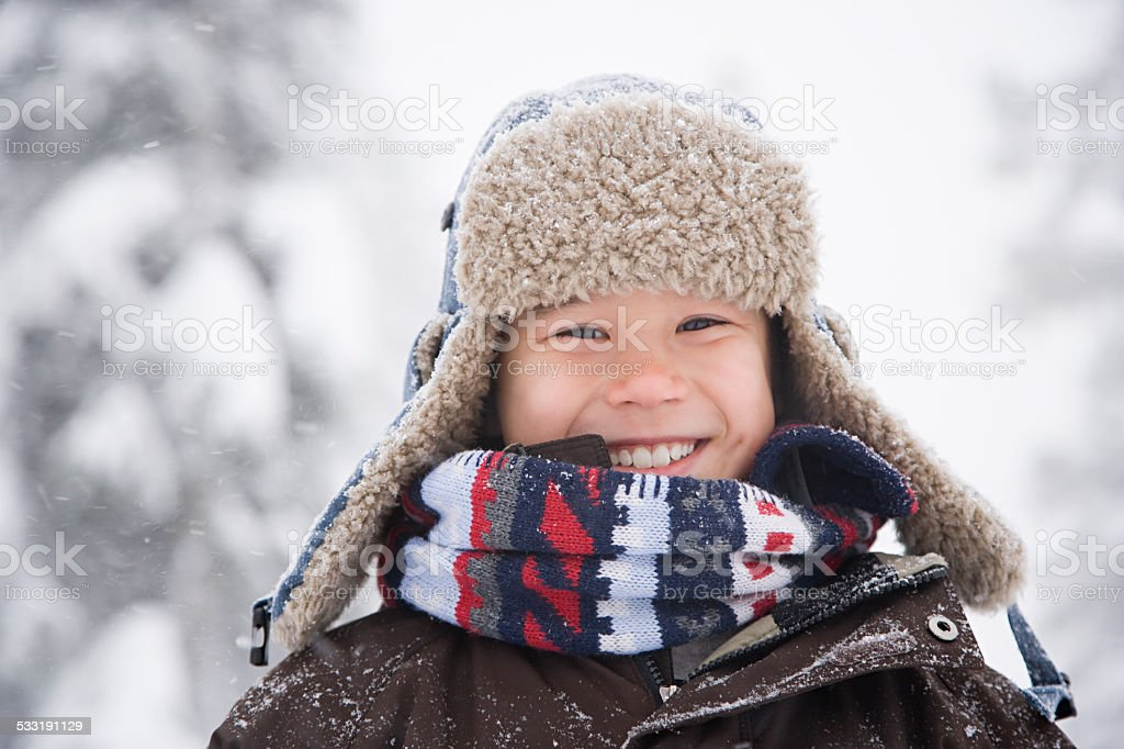 Boy in the snow stock photo