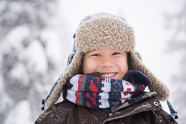 Boy in the snow Boy in the snow deerstalker hat stock pictures, royalty-free photos & images