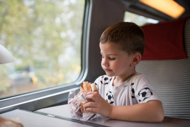 Boy in the train stock photo