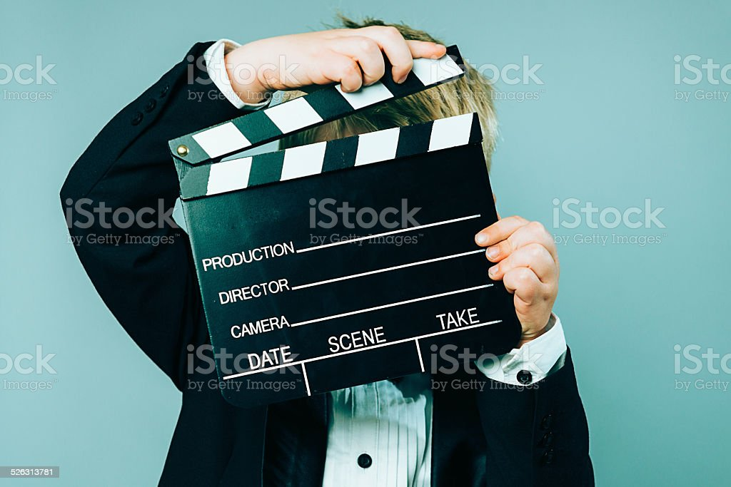 Boy in tuxedo is ready to make a movie stock photo
