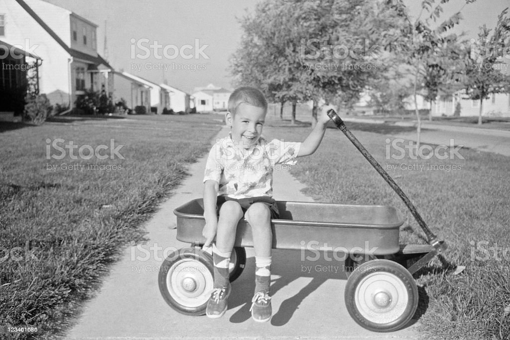 boy in wagon 1957, retro stock photo