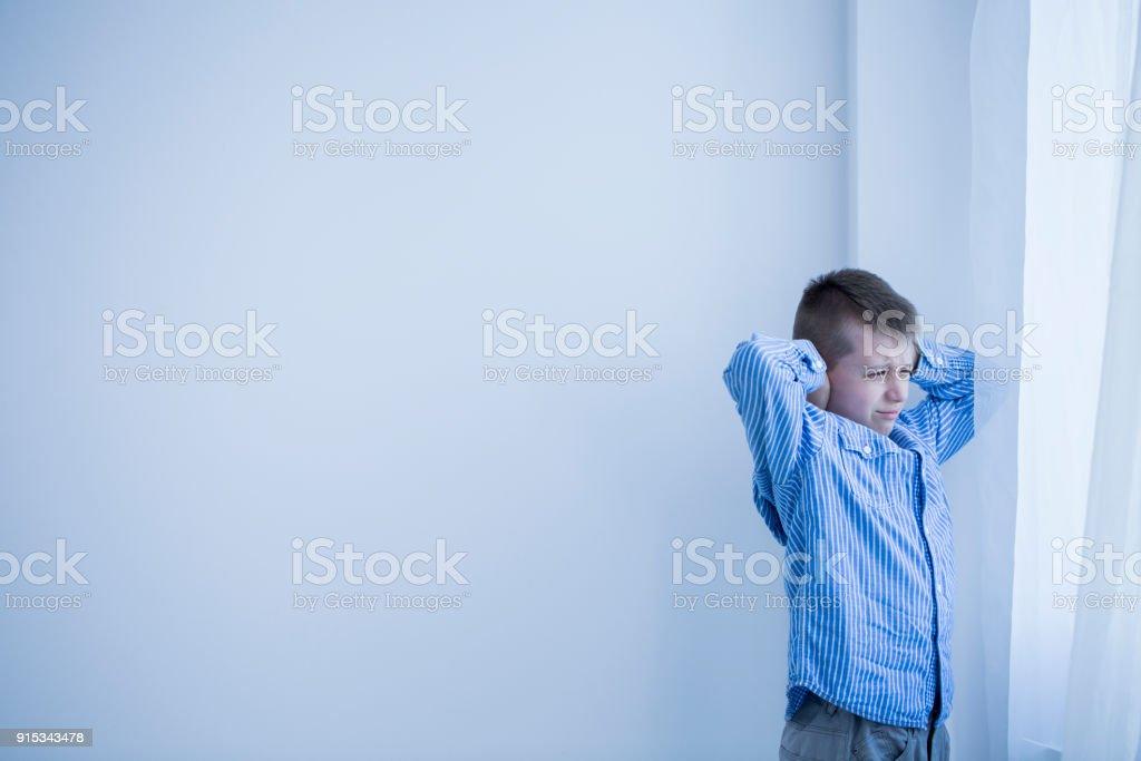 Boy in white room stock photo
