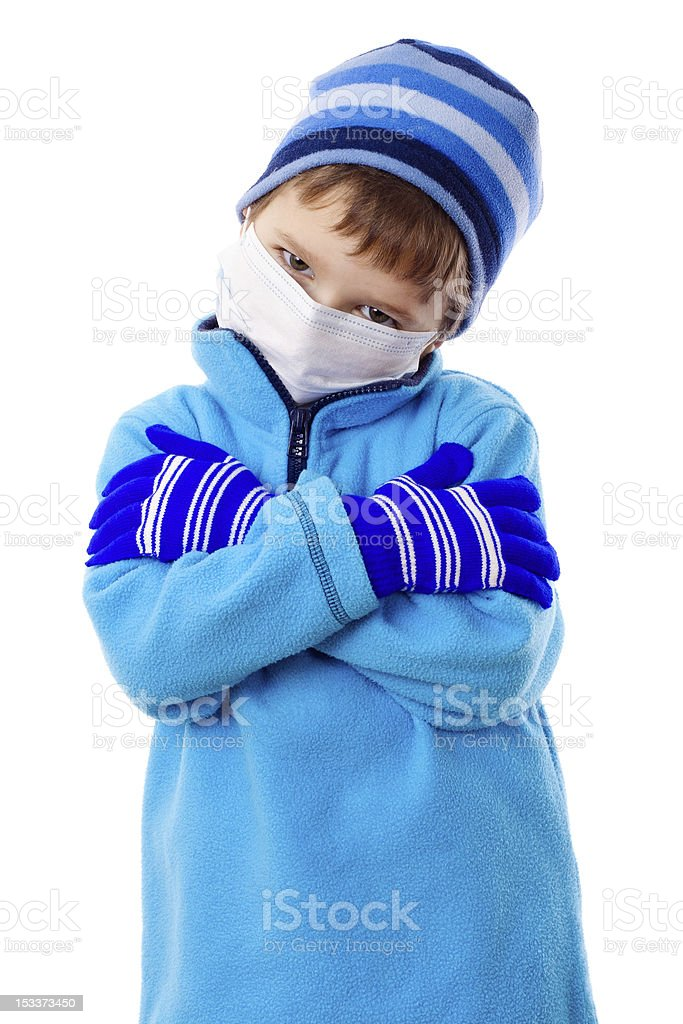 Boy in winter clothes and medical mask royalty-free stock photo