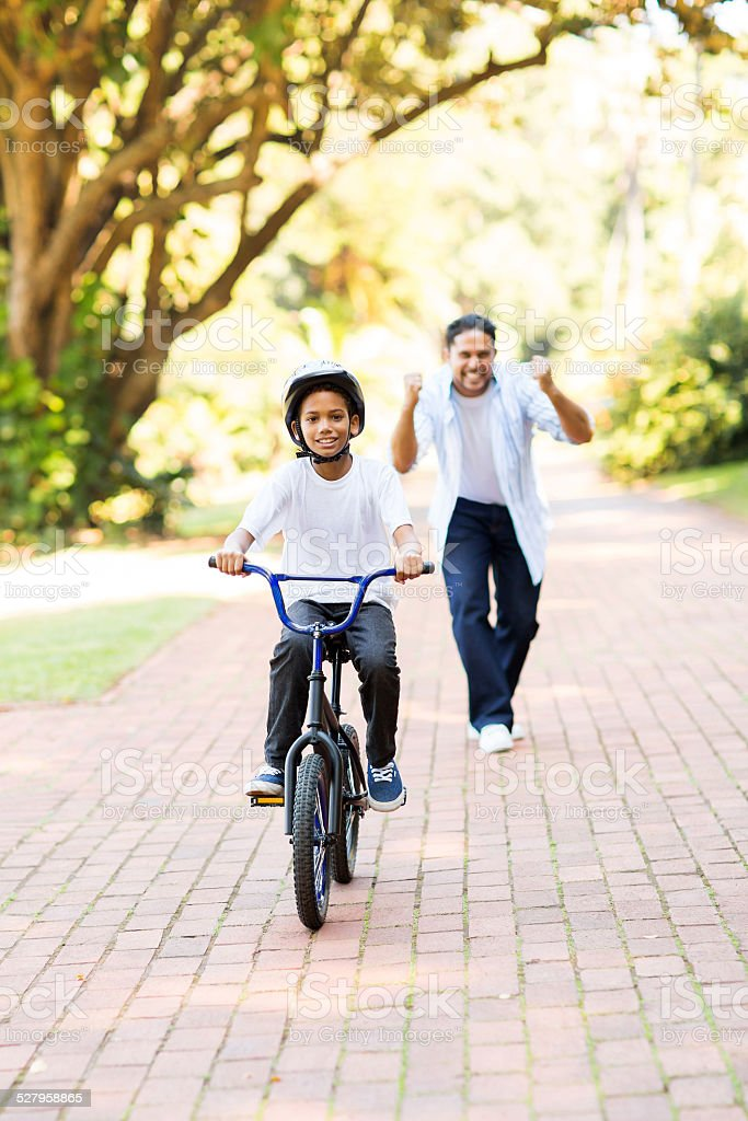 boy is able to ride a bike on his own stock photo