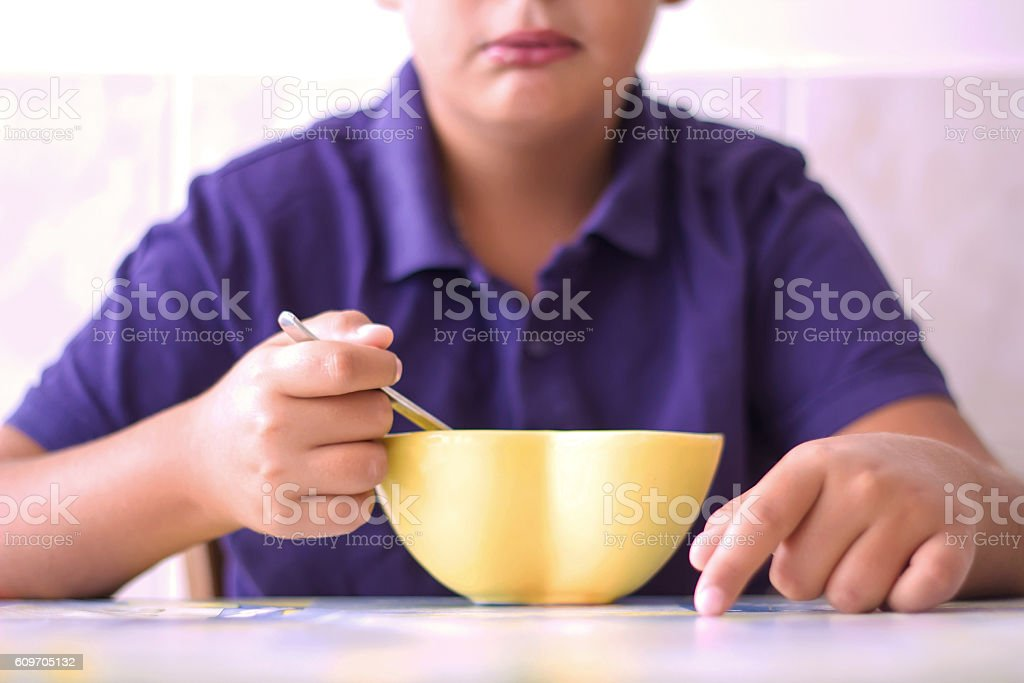 Boy Is Eating Chocolate Corn Flakes stock photo