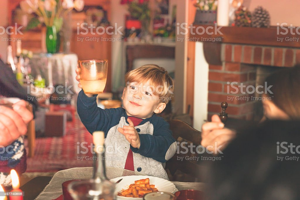 Boy is holding the glass for happy new year's toast stock photo