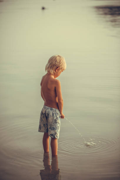 Peeing On The Beach Stock Photos, Pictures & Royalty-Free