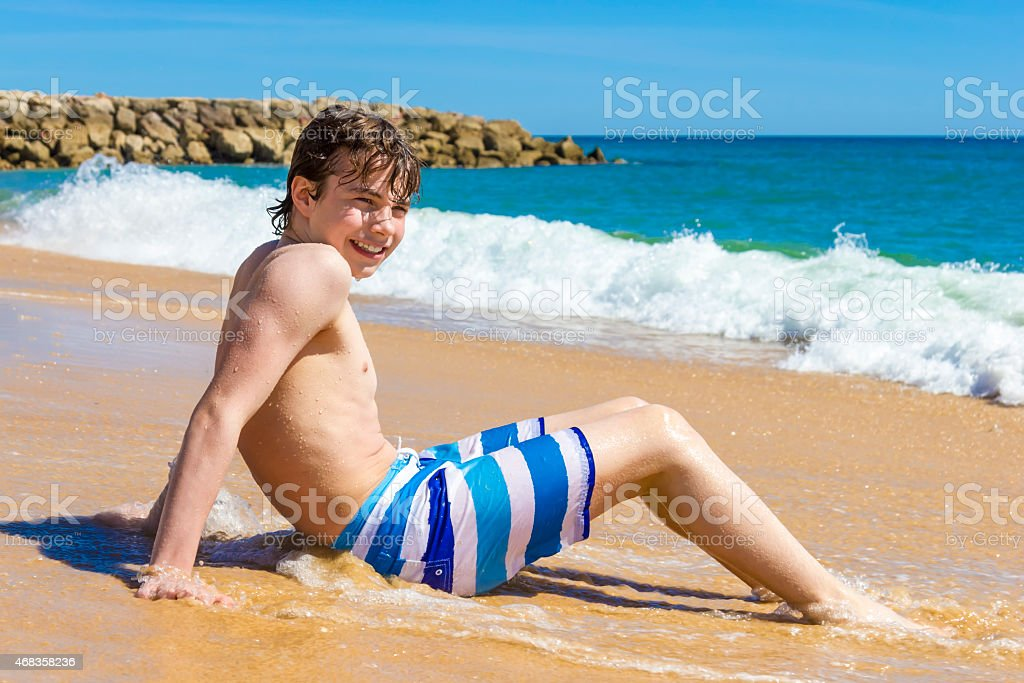 boy is playing  in a beautiful sea royalty-free stock photo