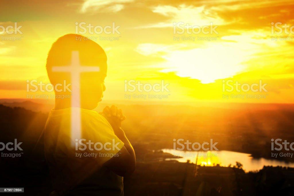 Boy is praying stock photo