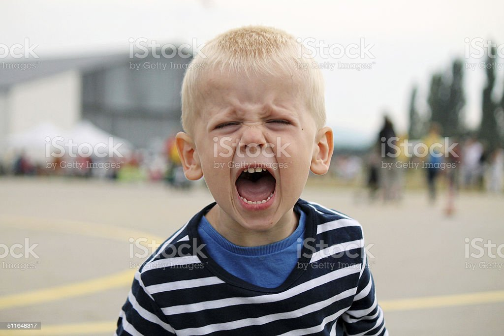 Boy is shouting stock photo