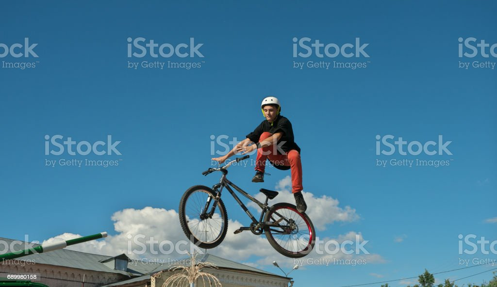 boy jumping and riding on a BMX bicycle stock photo