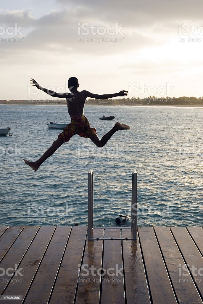 boy jumping for joy royalty-free stock photo